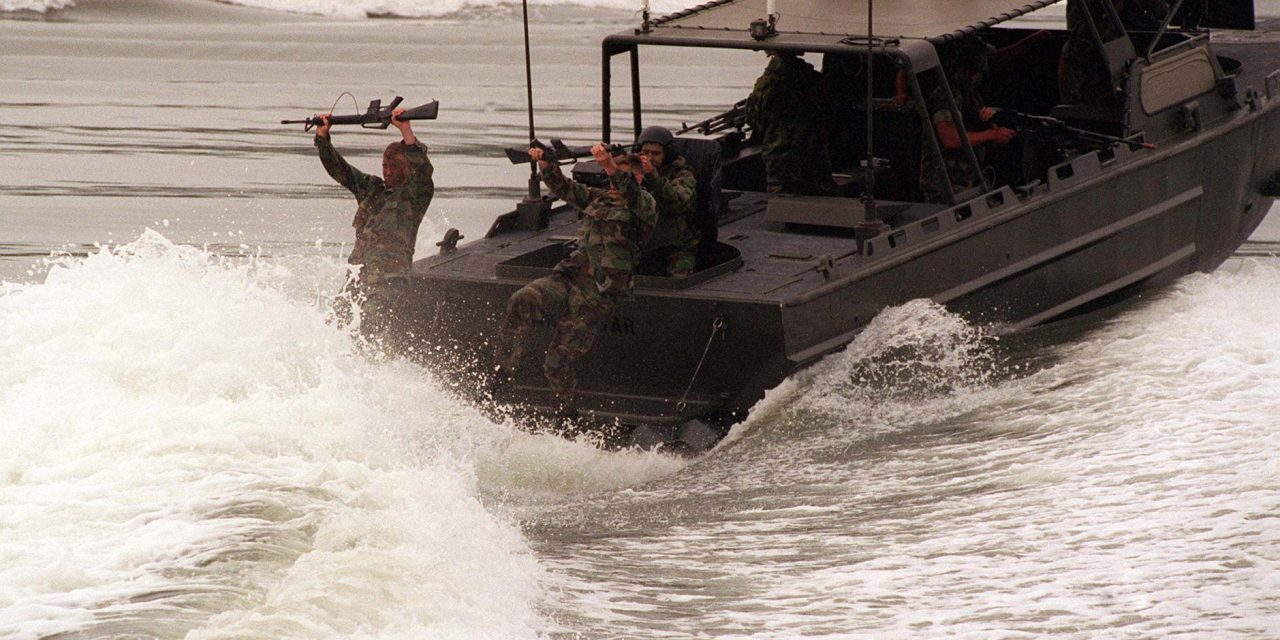960508-M-7232C-002 	U.S. Marines from the 2nd Reconnaissance Company cast off of a Riverine Assault Craft during a Revised Capabilities Exercise at Camp Lejeune, N.C., on May 8, 1996.  The Recon Marines and the assault craft are part of the 2nd Marine Division.  DoD photo by Lance Cpl. C.D. Clark, U.S. Marine Corps.