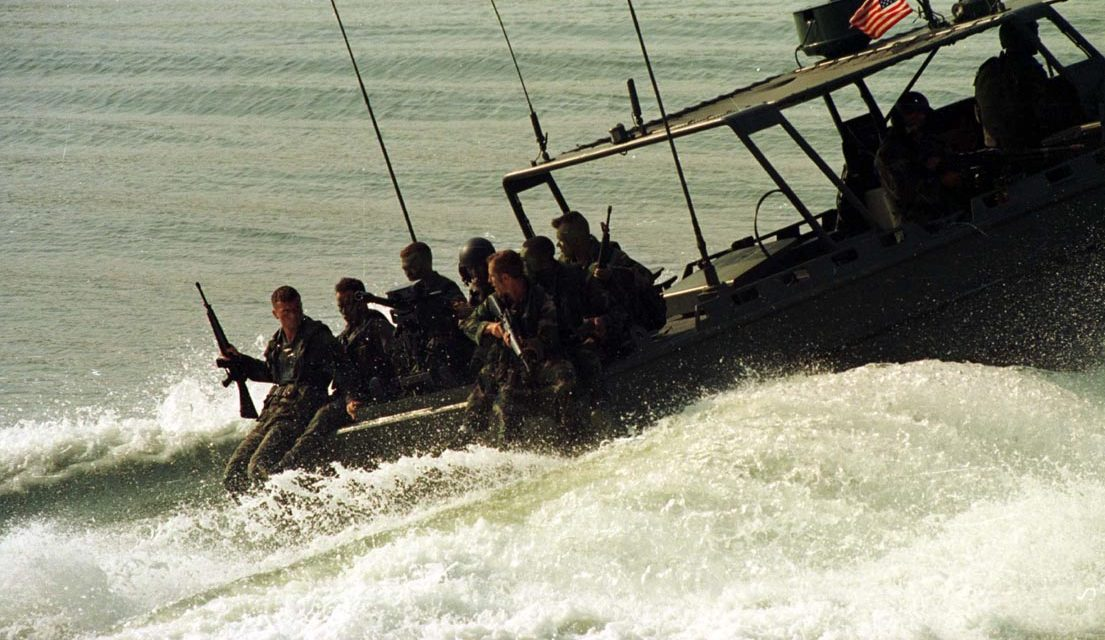 960620-M-0707S-001  Marines from 2d Reconnaissance Company ride on a Riverine Assault Craft from 2d Small Craft Company prior to casting into the water during the hostage rescue portion of Preying Mantis II.  Praying Mantis II was a Headquarters Battalion, 2d Marine Division field exercise conducted at Camp Lejeune, NC.  During this two week long exercise, Headquarters Battalion Marines conducted evolutions to include Mass Casualty drills, Hostage Rescue drills, and operations in support of Small Craft Company, performing its riverine function.  2d Marine Division Combat Camera imagery by LCpl. M.A. Sunderland.